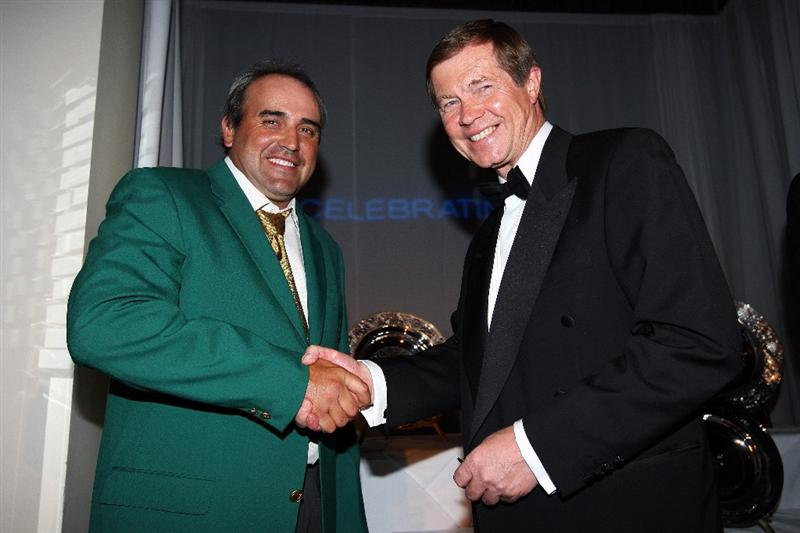 WENTWORTH, ENGLAND - MAY 19:  2009 Masters Champion Angel Cabrera of Argentina (L) shakes hands with George O'Grady, Chief Executive of The European Tour, at The European Tour Dinner during the BMW PGA Championship at Wentworth on May 19, 2009 in Virginia Water, England.  (Photo by Andrew Redington/Getty Images)
