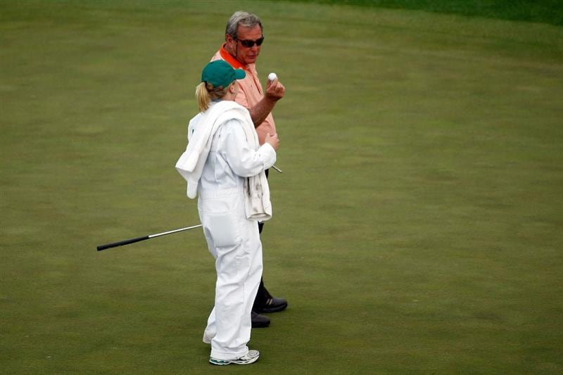 AUGUSTA, GA - APRIL 10:  Fuzzy Zoeller hands his signed golf ball to daughter/caddie Gretchen after his final Masters at the 2009 Masters Tournament at Augusta National Golf Club on April 10, 2009 in Augusta, Georgia.  (Photo by Jamie Squire/Getty Images)