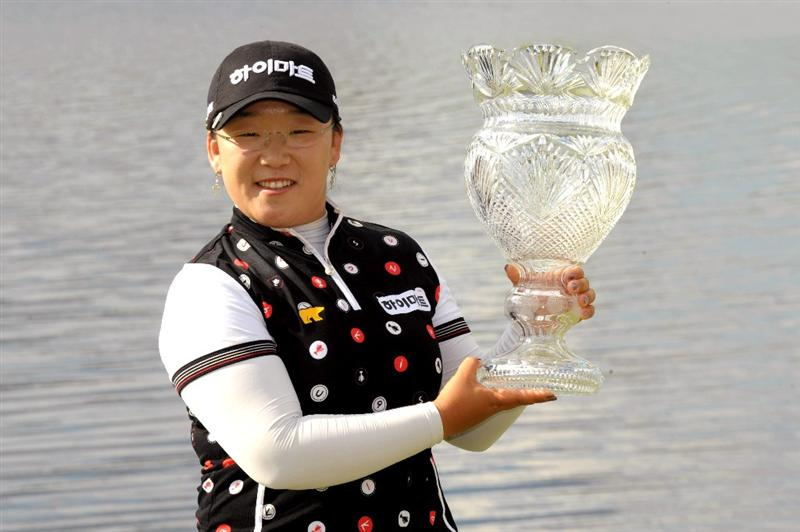 WEST PALM BECH, FL - NOVEMBER 23:  Ji-Yai Shin poses with the trophy after a one-stroke victory at the ADT Championship at the Trump International Golf Club on November 23, 2008 in West Palm Beach, Florida.  (Photo by Montana Pritchard/Getty Images)