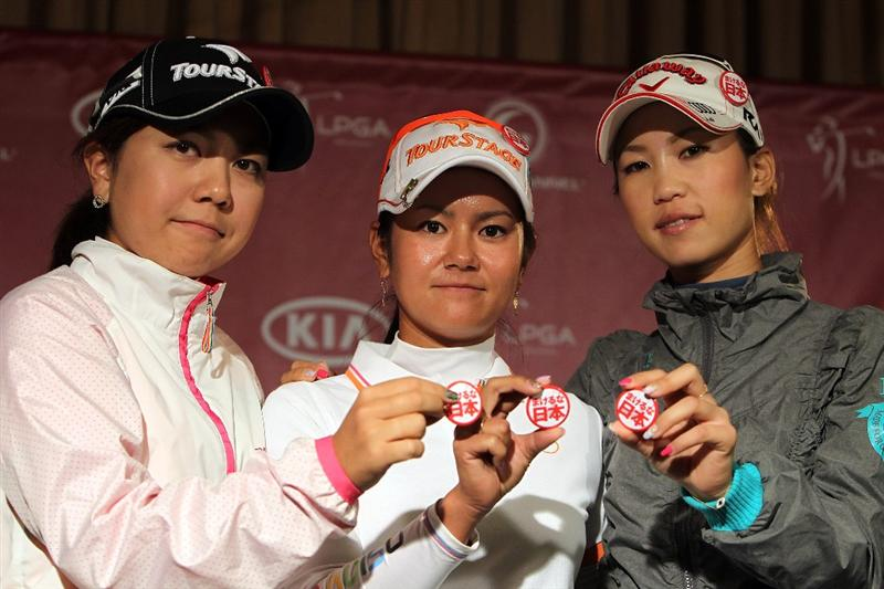 CITY OF INDUSTRY, CA - MARCH 22:  Ai Miyazato (C), Momoko Ueda (R), and Mika Miyazato of Japan hold pins to promote raising funds through First Giving/Never Give Up Japan for the Japanese earthquake and tsunami during a press conference before the start of the LPGA Kia Classic on March 22, 2011 at the Industry Hills Golf Club in the City of Industry, California.  (Photo by Scott Halleran/Getty Images)