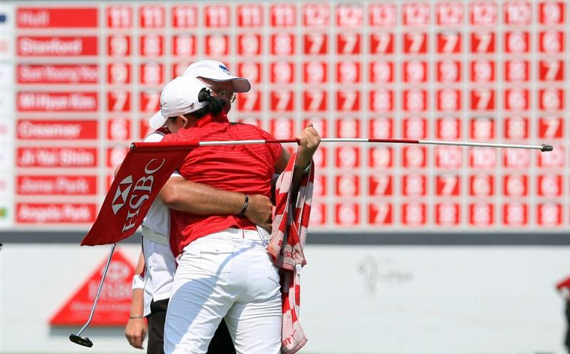 SINGAPORE - MARCH 08:  Jiyai Shin of South Korea celebrates with her caddie during the final round of HSBC Women's Champions at the Tanah Merah Country Club on March 8, 2009 in Singapore.  (Photo by Ross Kinnaird/Getty Images)