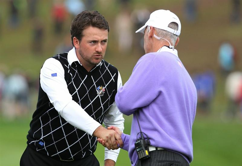 NEWPORT, WALES - OCTOBER 02:  USA Team Captain Corey Pavin (R) shakes hands with Graeme McDowell of Europe during the rescheduled Afternoon Foursome Matches during the 2010 Ryder Cup at the Celtic Manor Resort on October 2, 2010 in Newport, Wales.  (Photo by Andy Lyons/Getty Images)