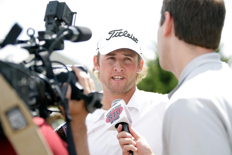 OVERLAND PARK, KS - AUGUST 21:  Michael Sim of Australia talks with the media following the second round of the Nationwide Christmas in October Classic on August 21, 2009 at Lions Gate Golf Club in Overland Park, Kansas.  (Photo by Jamie Squire/Getty Images)