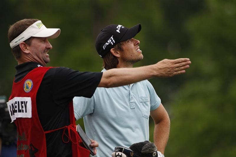 HUMBLE, TX - APRIL 03: Aaron Baddeley of Australia and his caddie check the wind direction on the 11th tee box during the final round of the Shell Houston Open at Redstone Golf Club on April 3, 2011 in Humble, Texas.  (Photo by Michael Cohen/Getty Images)