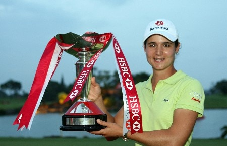 SINGAPORE - MARCH 02:  Lorena Ochoa of Mexico  with the winners trophy after the final round of the HSBC Women's Champions at the Tanah Merah Country Club on March 2, 2008 in Singapore.  (Photo by Ross Kinnaird/Getty Images)