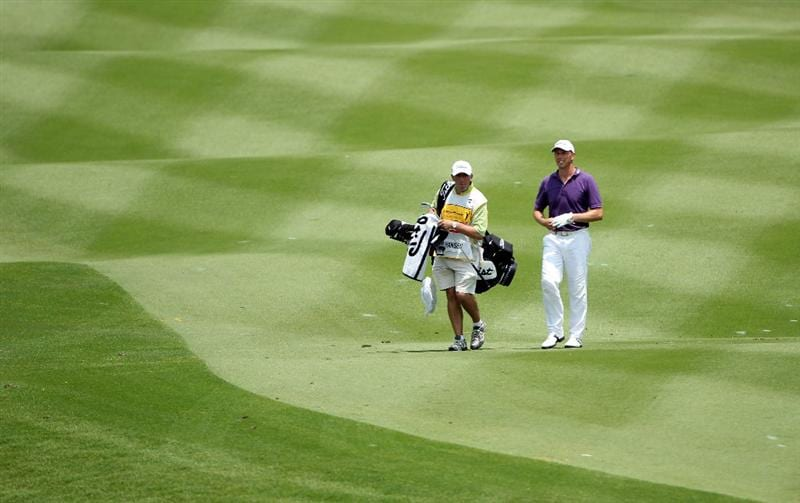 KUALA LUMPUR, MALAYSIA - MARCH 05:  Soren Hansen of Denmark walks with his caddie Phil 'Wobbly' Morbey on the ninth hole during the second round of the Maybank Malaysia Open at the Kuala Lumpur Golf & Country on March 5, 2010 in Kuala Lumpur, Malaysia.  (Photo by Ross Kinnaird/Getty Images)