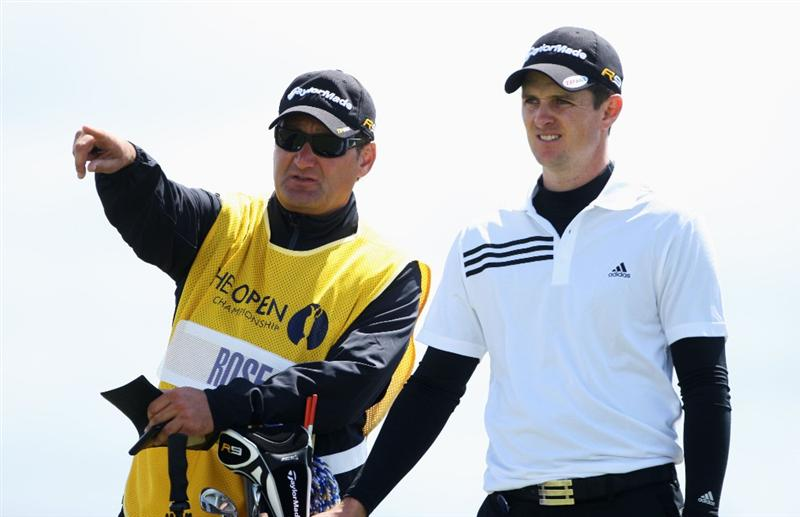 TURNBERRY, SCOTLAND - JULY 19:  Justin Rose of England lines up a shot with caddy Mark Fulcher during the final round of the 138th Open Championship on the Ailsa Course, Turnberry Golf Club on July 19, 2009 in Turnberry, Scotland.  (Photo by Andrew Redington/Getty Images)