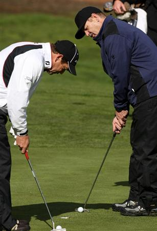PEBBLE BEACH, CA - FEBRUARY 13: Comedian Bill Murray and singer Huey Lewis putt out simultaneously on the 11th hole at Poppy Hills Golf Course during the second round of the the AT&T Pebble Beach National Pro-Am on February 13, 2009 in Pebble Beach, California. (Photo by Stephen Dunn/Getty Images)