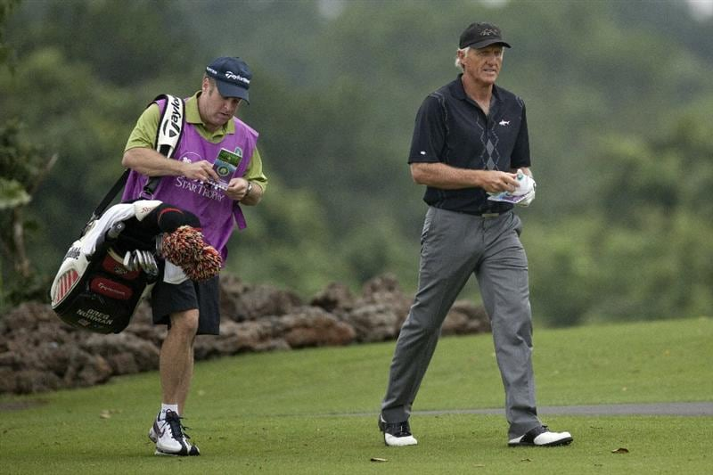 HAIKOU, CHINA - OCTOBER 28: Golf Legend Greg Norman of Australia walks with his caddie during the Mission Hills Star Trophy at Blackstone Course, Mission Hill Hainan on October 28, 2010 in Haikou, China. The Mission Hills Star Trophy is Asia's leading leisure lifestyle event which features Hollywood celebrities and international golf stars.  (Photo by Athit Perawongmetha/Getty Images)