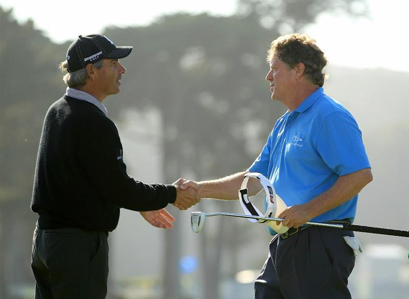 SAN FRANCISCO - NOVEMBER 06:  Michael Allen (right) shakes hands with Fred Couples after he finished at 10-under par to take the lead after round 3 of the Charles Schwab Cup Championship at Harding Park Golf Course on November 6, 2010 in San Francisco, California.  (Photo by Ezra Shaw/Getty Images)