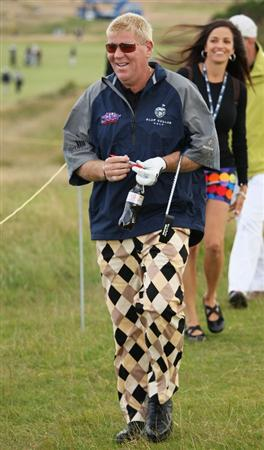 TURNBERRY, SCOTLAND - JULY 14:  John Daly of USA walks with a female companion during a practice round prior to the 138th Open Championship on the Ailsa Course, Turnberry Golf Club on July 14, 2009 in Turnberry, Scotland.  (Photo by Ross Kinnaird/Getty Images)