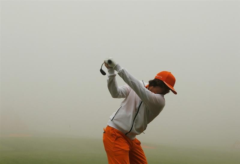 SHANGHAI, CHINA - NOVEMBER 07:  Rickie Fowler of the USA hits a shot on the practice ground during a fog delay in the final round of the HSBC Champions at the Sheshan Golf Club on November 7, 2010 in Shanghai, China.  (Photo by Scott Halleran/Getty Images)