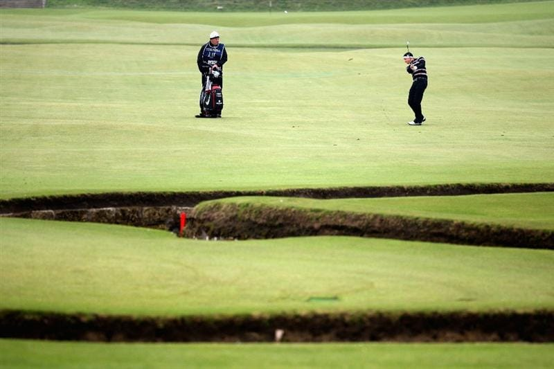 ST ANDREWS, SCOTLAND - OCTOBER 10: Simon Dyson of England plays his second shot to the first hole during the final round of The Alfred Dunhill Links Championship at The Old Course on October 10, 2010 in St Andrews, Scotland.  (Photo by Warren Little/Getty Images).