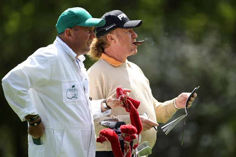 AUGUSTA, GA - APRIL 05:  Miguel Angel Jimenez of Spain waits in a fairway alongside his caddie Mark Stannard during a practice round prior to the 2011 Masters Tournament at Augusta National Golf Club on April 5, 2011 in Augusta, Georgia.  (Photo by Jamie Squire/Getty Images)