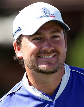 ORLANDO, FL - MARCH 14:  Graeme McDowell of Northern Ireland smiles during the first day of the Tavistock Cup at Isleworth Golf and Country Club on March 14, 2011 in Orlando, Florida.  (Photo by Sam Greenwood/Getty Images)