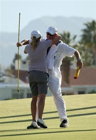 RANCHO MIRAGE,CA - APRIL 3:  Stacy Lewis hugs caddie Travis Wilson after her victory in the final round of the Kraft Nabisco Championship at Mission Hills Country Club on April 3, 2011 in Rancho Mirage, California.  (Photo by Stephen Dunn/Getty Images)