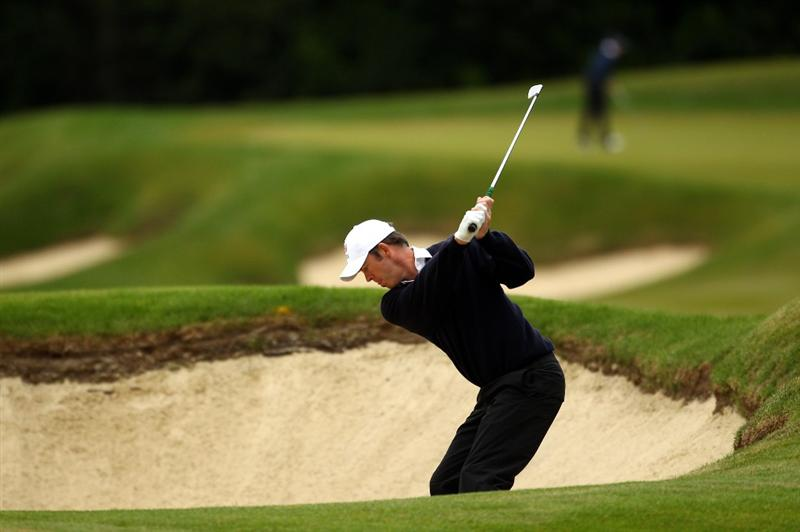 VIRGINIA WATER, ENGLAND - MAY 27:  Richard Green of Australia hits from a bunker on the 3rd hole  during the second round of the BMW PGA Championship at the Wentworth Club on May 27, 2011 in Virginia Water, England.  (Photo by Richard Heathcote/Getty Images)