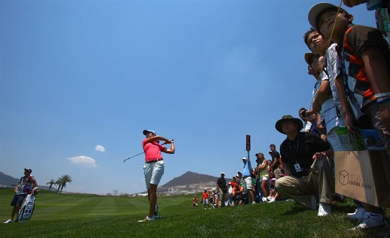 MORELIA, MEXICO- APRIL 25:  Lorena Ochoa of Mexico hits out of the rough on the 2nd fairway during the thrid round of the Corona Championship at the Tres Marias Residential Golf Club on April 25, 2009 in Morelia, Michoacan, Mexico. (Photo by Donald Miralle/Getty Images)
