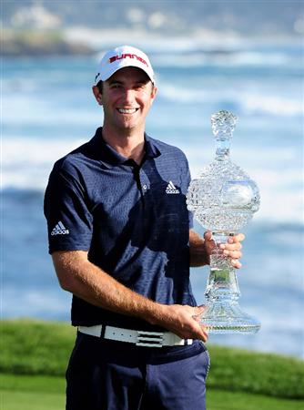 PEBBLE BEACH, CA - FEBRUARY 14:  Dustin Johnson holds the trophy after winning the AT&T Pebble Beach National Pro-Am at Pebble Beach Golf Links on February 14, 2010 in Pebble Beach, California.  (Photo by Stuart Franklin/Getty Images)
