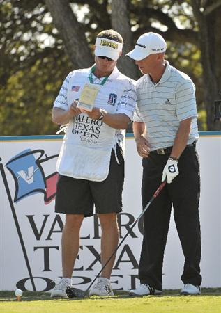 SAN ANTONIO, TX - OCTOBER 9:  Nathan Green of Australia (R) checks yardage with his caddy Jason during the first round of the Valero Texas Open at La Cantera Golf Club on October 9, 2008 in San Antonio, Texas.  (Photo by Marc Feldman/Getty Images)