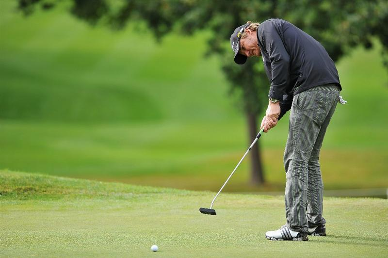 PARIS - SEPTEMBER 24:  Jarmo Sandelin of Sweden plays his putt at the seventeenth hole during day two of the Vivendi cup at Joyenval Golf course on September 24, 2010 outside Paris, France.  (Photo by Pascal Le Segretain/Getty Images)
