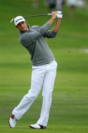 PEBBLE BEACH, CA - JUNE 18:  Dustin Johnson hits his approach on the second hole during the second round of the 110th U.S. Open at Pebble Beach Golf Links on June 18, 2010 in Pebble Beach, California.  (Photo by Donald Miralle/Getty Images)