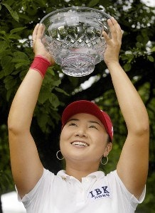 Jeong Jang raises her trophy after winning the Wegmans LPGA with a 13-under 275 at Locust Hill Country Club in Rochester, New York on Sunday, June 25, 2006.Photo by Kevin Rivoli/WireImage.com