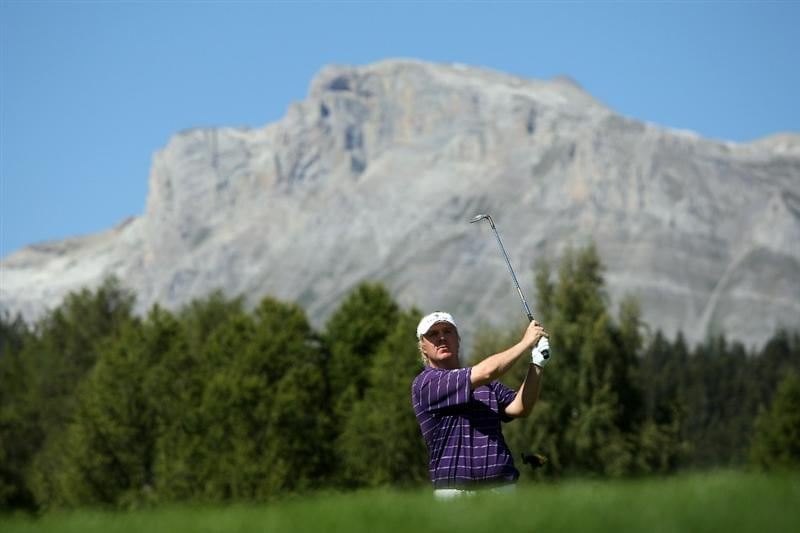 CRANS, SWITZERLAND - SEPTEMBER 06:  Ross McGowan of England plays his second shot on the 12th hole during the final round of The Omega European Masters at Crans-Sur-Sierre Golf Club on September 6, 2009 in Crans Montana, Switzerland.  (Photo by Andrew Redington/Getty Images)