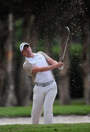 HONG KONG - NOVEMBER 13:  Scott Drummond of Scotland plays his bunker shot on the 18th hole during the second round of the UBS Hong Kong Open at the Hong Kong Golf Club on November 13, 2009 in Fanling, Hong Kong.  (Photo by Stuart Franklin/Getty Images)