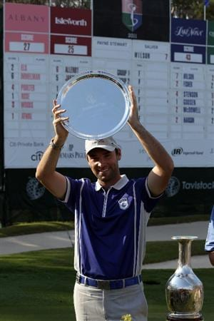 WINDERMERE, FL - MARCH 15: Oliver Wilson of England with the Payne Stewart Salver for the low round medalist award after his round of 7 under par 65 during the second day of the 2011 Tavistock Cup at Isleworth Golf and Country Club on March 15, 2011 in Windermere, Florida.  (Photo by David Cannon/Getty Images)