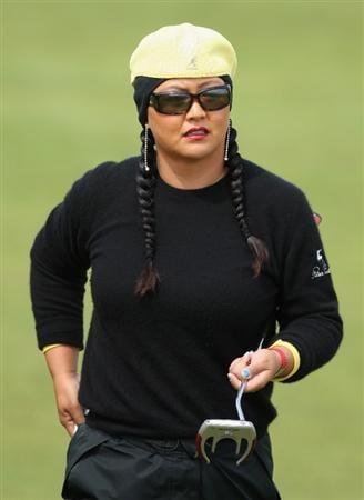 LYTHAM ST ANNES, ENGLAND - AUGUST 01:  Christina Kim of USA walks to the 2nd green during the third round of the 2009 Ricoh Women's British Open Championship held at Royal Lytham St Annes Golf Club, on August 1, 2009 in Lytham St Annes, England.  (Photo by David Cannon/Getty Images)