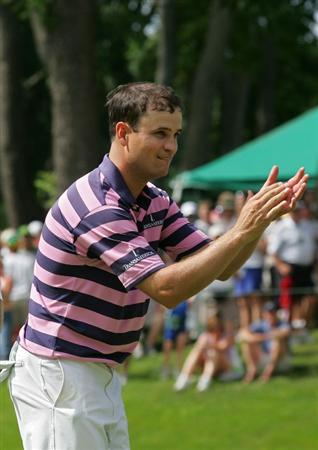 SILVIS, IL - JULY 12:  Zack Johnson of the USA applauds the gallery as he finishes his round during the final round of the John Deere Classic at TPC Deere Run held on July 12, 2009 in Silvis, Illinois.  (Photo by Michael Cohen/Getty Images)