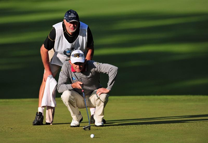 TURIN, ITALY - MAY 07:  Markus Brier of Austria and caddie Max Zechmann line up a putt on the 10th hole during the first round of the BMW Italian Open at Royal Park I Roveri on May 7, 2009 near Turin, Italy.  (Photo by Stuart Franklin/Getty Images)