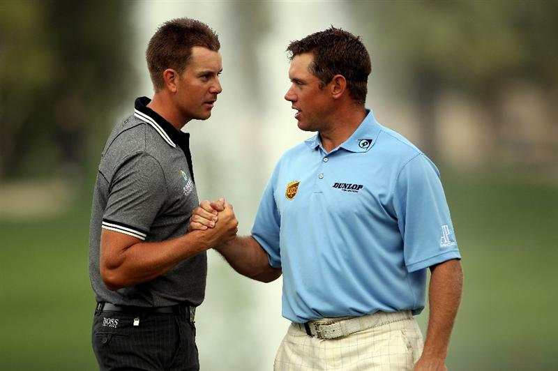 DUBAI, UNITED ARAB EMIRATES - FEBRUARY 05:  Lee Westwood of England (right) shakes hands with Henrik Stenson of Sweden on the 18th hole during the second round of the Omega Dubai Desert Classic on February 5, 2010 in Dubai, United Arab Emirates.  (Photo by Andrew Redington/Getty Images)