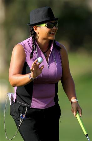 CARLSBAD, CA - MARCH 26: Christina Kim holds up her ball after making a birdie putt on the 11th hole during the second round of the Kia Classic Presented by J Golf at La Costa Resort and Spa on March 26, 2010 in Carlsbad, California. (Photo by Stephen Dunn/Getty Images)
