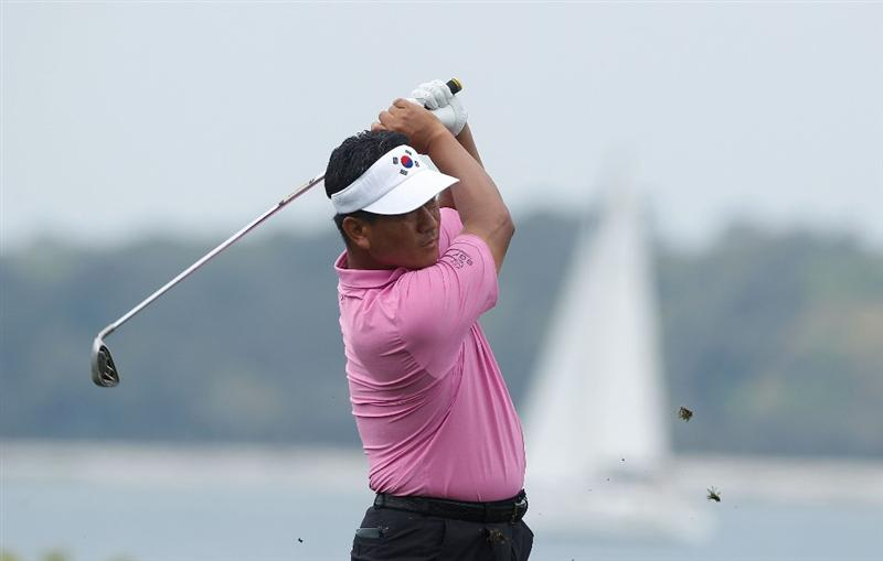 HILTON HEAD ISLAND, SC - APRIL 15:  K.J. Choi of South Korea hits his approach shot on the 18th hole during the first round of the Verizon Heritage at the Harbour Town Golf Links on April 15, 2010 in Hilton Head lsland, South Carolina.  (Photo by Scott Halleran/Getty Images)