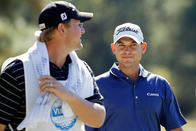 MADISON, MS - OCTOBER 03:  Bill Haas (R) walks with his caddie during the final round of the Viking Classic held at Annandale Golf Club on October 3, 2010 in Madison, Mississippi.  (Photo by Michael Cohen/Getty Images)