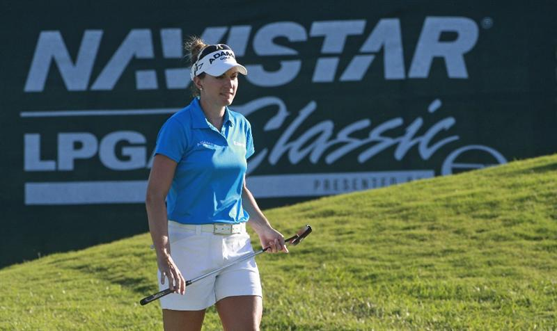 PRATTVILLE, AL - OCTOBER 3:  Brittany Lang walks across the 18th green during third round play in the Navistar LPGA Classic at the Robert Trent Jones Golf Trail at Capitol Hill on October 3, 2009 in  Prattville, Alabama.  (Photo by Dave Martin/Getty Images)