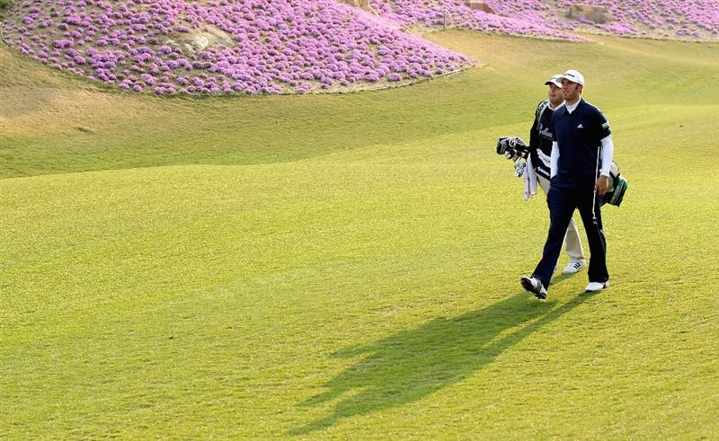 ICHEON, SOUTH KOREA - APRIL 29:  Dustin Johnson of the USA walks with his caddie on the tenth hole during the second round of the Ballantine's Championship at Blackstone Golf Club on April 29, 2011 in Icheon, South Korea.  (Photo by Andrew Redington/Getty Images)