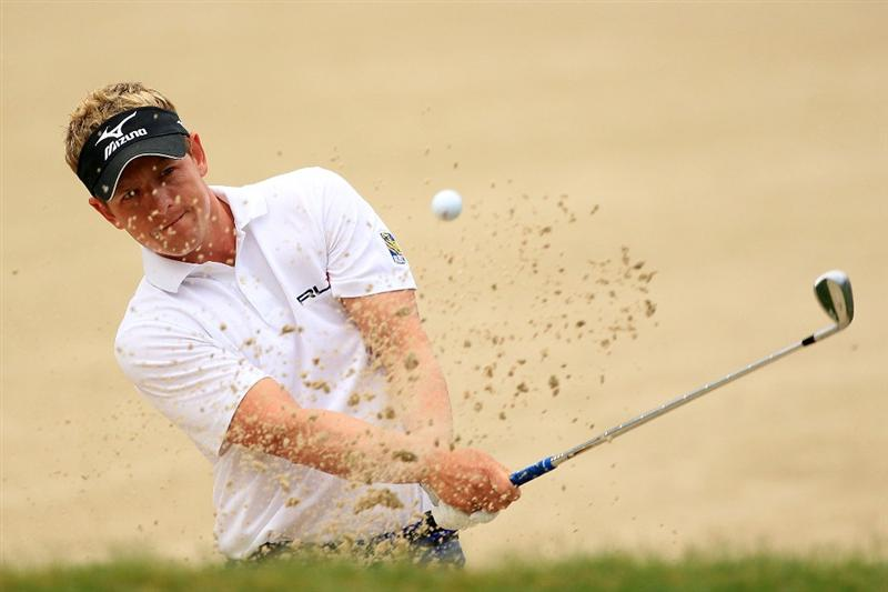 PONTE VEDRA BEACH, FL - MAY 15:  Luke Donald of England hits from a bunker on the tenth hole during the continuation of the third round of THE PLAYERS Championship held at THE PLAYERS Stadium course at TPC Sawgrass on May 15, 2011 in Ponte Vedra Beach, Florida.  (Photo by Streeter Lecka/Getty Images)