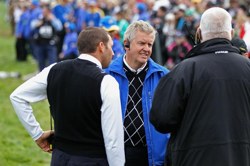 NEWPORT, WALES - OCTOBER 02:  European Team Captain Colin Montgomerie (C) chats with rules official John Paramor and his vice captain Sergio Garcia during the rescheduled Afternoon Foursome Matches during the 2010 Ryder Cup at the Celtic Manor Resort on October 2, 2010 in Newport, Wales.  (Photo by David Cannon/Getty Images)