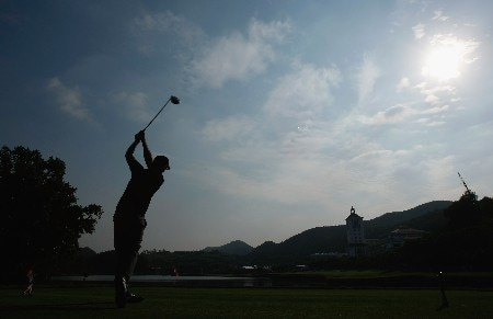 SHENZHEN, CHINA - NOVEMBER 24:  Gregory Havret of France plays his tee shot on the 18th hole during the third round of the Omega Mission Hills World Cup at the Mission Hills Golf Resort on November 24, 2007 in Shenzhen, China.  (Photo by Stuart Franklin/Getty Images)