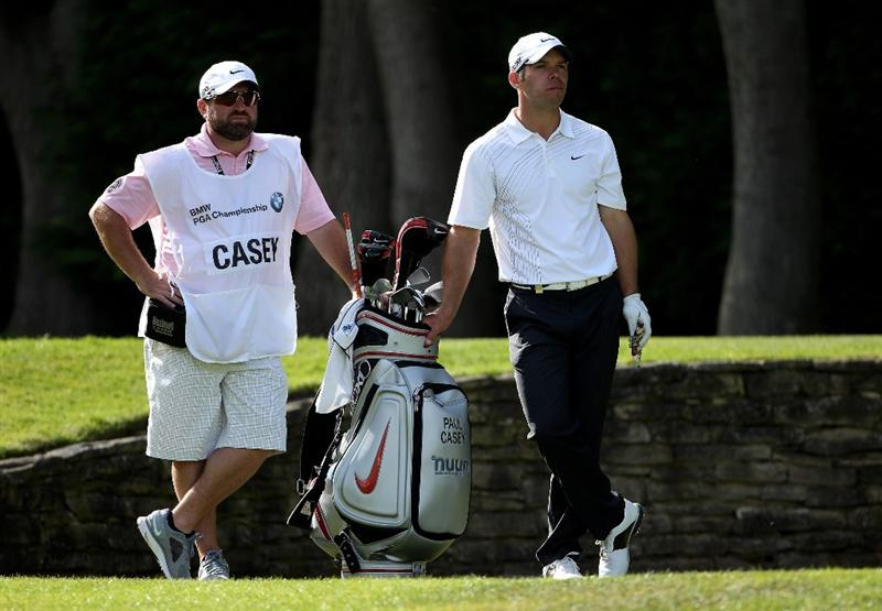 VIRGINIA WATER, ENGLAND - MAY 25:  Paul Casey of England looks on with his caddie Craig Connolly during the Pro-Am round prior to the BMW PGA Championship at Wentworth Club on May 25, 2011 in Virginia Water, England.  (Photo by Andrew Redington/Getty Images)
