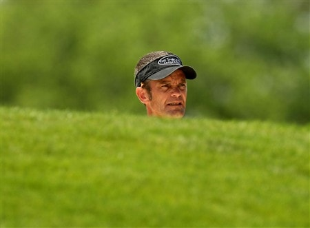 IRVING, TX - APRIL 25:  Jesper Parnevik of Sweden surveys his lie in a fairway bunker on the fourth hole during the second round of the EDS Byron Nelson Championship at TPC Four Seasons Resort Las Colinas on April 25, 2008 in Irving, Texas.  (Photo by Stephen Dunn/Getty Images)