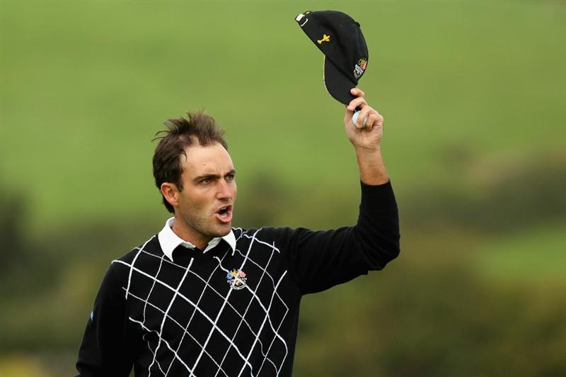 NEWPORT, WALES - OCTOBER 02:  Edoardo Molinari of Europe walks to the first tee during the rescheduled Afternoon Foursome Matches during the 2010 Ryder Cup at the Celtic Manor Resort on October 2, 2010 in Newport, Wales.  (Photo by Ross Kinnaird/Getty Images)