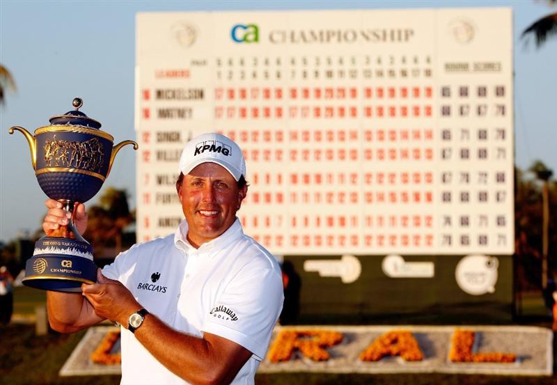DORAL, FL - MARCH 15:  Phil Mickelson hoists the trophy after winning the World Golf Championships-CA Championship on March 15, 2009 at the Doral Golf Resort and Spa in Doral, Florida.  (Photo by Jamie Squire/Getty Images)