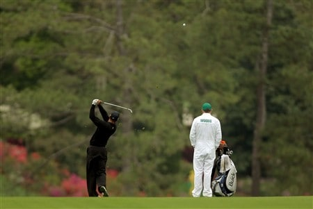 AUGUSTA, GA - APRIL 08:  Tiger Woods hits a tee shot as his caddie Steve Williams watches during the second day of practice prior to the start of the 2008 Masters Tournament at Augusta National Golf Club on April 8, 2008 in Augusta, Georgia.  (Photo by Harry How/Getty Images)