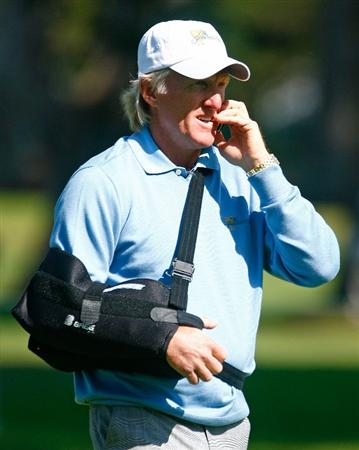 SAN FRANCISCO - OCTOBER 06:  International Team captain Greg Norman speaks on a mobile phone as he watches the play during a practice round prior to the start of The Presidents Cup at Harding Park Golf Course on October 6, 2009 in San Francisco, California.  (Photo by Scott Halleran/Getty Images)