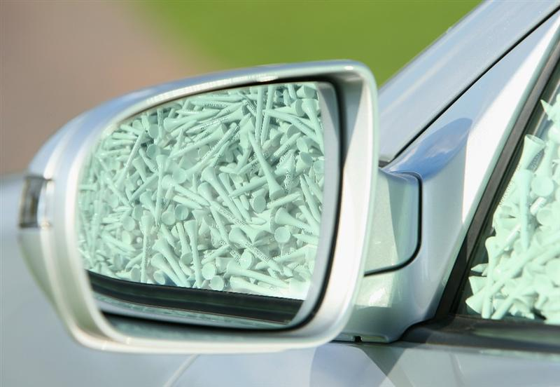 COLOGNE, GERMANY - SEPTEMBER 10:   Tee pegs are reflected in the wing mirror of the sponsors car at The Mercedes-Benz Championship at The Gut Larchenhof Golf Club on September 10, 2008, in Pulheim, near Cologne, Germany.  (Photo by Stuart Franklin/Getty Images)