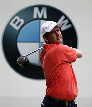 VIRGINIA WATER, ENGLAND - MAY 18:  Peter Lawrie of Ireland tees off during a practice round at Wentworth prior to the BMW PGA Championship on May 18, 2010 in Virginia Water, England.  (Photo by Ross Kinnaird/Getty Images)